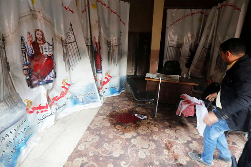 Blood stains are seen Dec. 29 on the floor of the Coptic Orthodox Church of Mar Mina in Helwan, Egypt, near Cairo. At least nine people were killed in attacks on the church and a Christian-owned shop, authorities said.