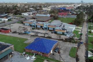Buildings damaged by Hurricane Laura are seen in an Aug. 30, 2020, aerial photograph in Lake Charles, La.