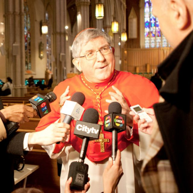 Cardinal Thomas ollins speaking to reporters at St. Michael's Cathedral February 29th. His sponsorship means a family of Iraqi Christian refugees should be in Canada before the end of April.