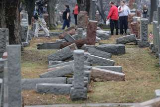 Local and national media report on more than 170 toppled Jewish headstones Feb. 21 after a vandalism attack on Chesed Shel Emeth Cemetery in University City, Mo. The incident at the cemetery near St. Louis was repeated in suburban Philadelphia Feb. 26 when gravestones were destroyed at a Jewish cemetery there.