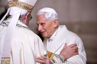 Pope Francis greets retired Pope Benedict XVI prior to the opening of the Holy Door of Saint Peter's Basilica at the Vatican Dec. 8, 2015. Pope Benedict said in a recent interview that was his duty to resign from papacy.