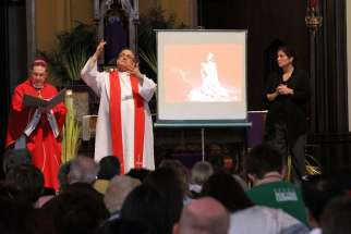 Auxiliary Bishop Andrzej J. Zglejszewski of Rockville Centre, N.Y. signs at a Mass. Spanish Conference of Catholic Bishops Deaf Ministry holds sign language at around 24 churches every week.