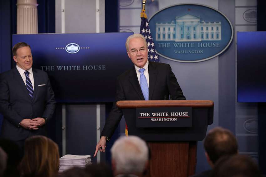 U.S. Health and Human Services Secretary Tom Price gestures at a stack of papers that he said was the Affordable Care Act during a March 7 press briefing as White House Press Secretary Sean Spicer looks on at the White House in Washington. The law, as passed in 2010, was 906 pages long. Republicans in the U.S. House have introduced a measure to repeal and replace the federal health care law.