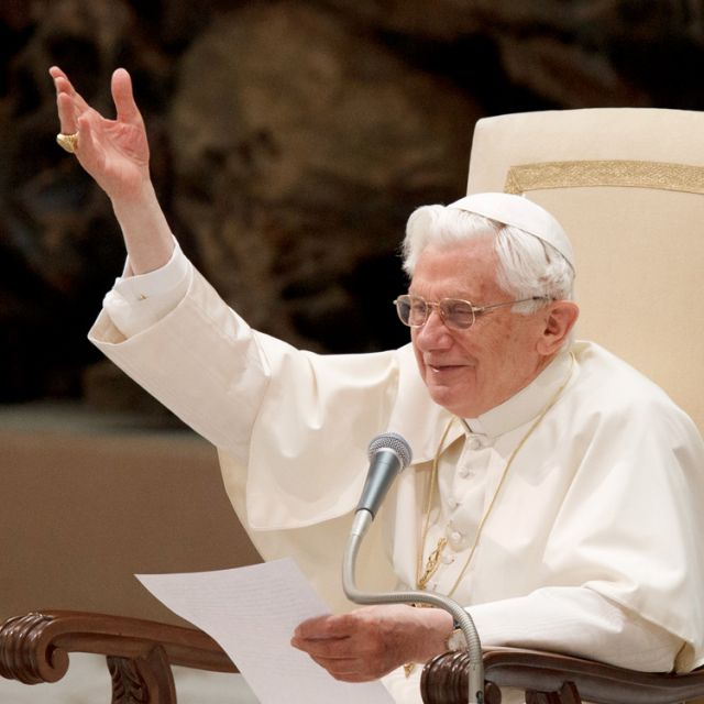 Pope Benedict XVI acknowledges pilgrims during his general audience in Paul VI hall at the Vatican Feb. 15.
