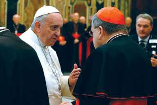 American Cardinal Raymond Burke, here shaking hands with Pope Francis, is one of four senior Churchmen demanding clarification on points of doctrine in Amoris Laetitia.