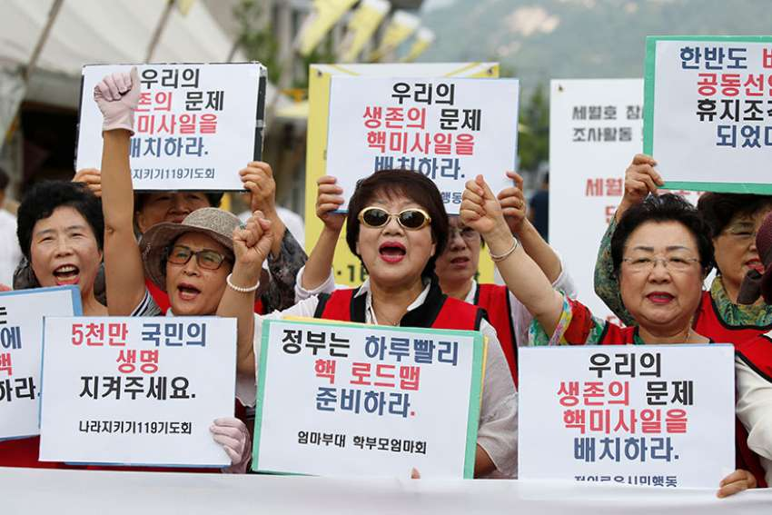 South Korean activists protest in Seoul against North Korea's fifth nuclear test Sept 12, 2016. South Korean Catholics are opposing their country's reliance on nuclear power and U.S. THAAD missile defence system.