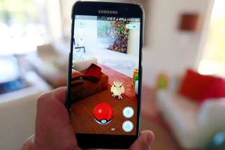 "The augmented reality mobile game ""Pokemon Go"" by Nintendo is shown on a smartphone screen in this photo illustration taken in Palm Springs, California on July 11, 2016."