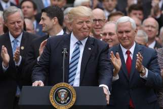 President Donald Trump gathers with Vice President Mike Pence and congressional Republicans at the White House in Washington May 4 after the House of Representatives approved a repeal of major parts of the Affordable Care Act and replace it with a Republican health care bill.