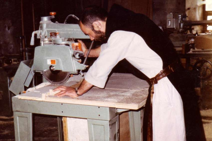 Father Christophe Lebreton works with a table saw at the Monastery of Notre Dame de l'Atlas near Medea, Algeria, in this undated photo. Father Lebreton and six other Trappist monks murdered in 1996 by the members of the Armed Islamic Group will be beatified Dec. 8 in Oran, Algeria.
