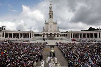 A statue of Our Lady of Fatima is carried through a crowd in 2016 at the Marian shrine of Fatima in central Portugal.