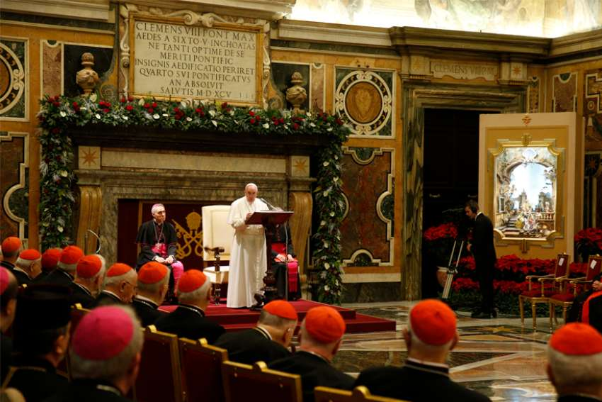 Pope Francis speaks during his annual audience to give Christmas greetings to members of the Roman Curia at the Vatican Dec. 21, 2019.