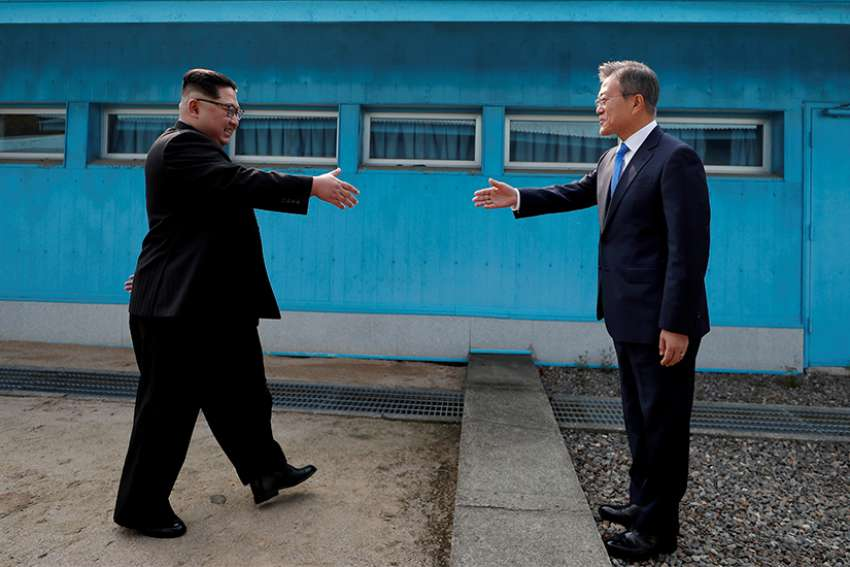 South Korean President Moon Jae-in, right, a practising Catholic, and North Korean leader Kim Jong Un shake hands inside the demilitarized zone separating the two Koreas April 27.