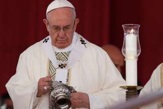 Pope Francis uses incense as he celebrates Mass at the Air Defense Stadium in Cairo April 29.