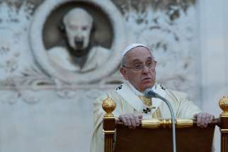 Pope Francis gives the homily as he celebrates Mass at the Verano cemetery in Rome Nov. 1, the feast of All Saints.