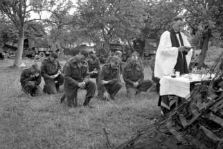 Chaplain John W. Forth presiding at a service for the Cameron Highlanders of Ottawa near Caen, France, in July 1944.