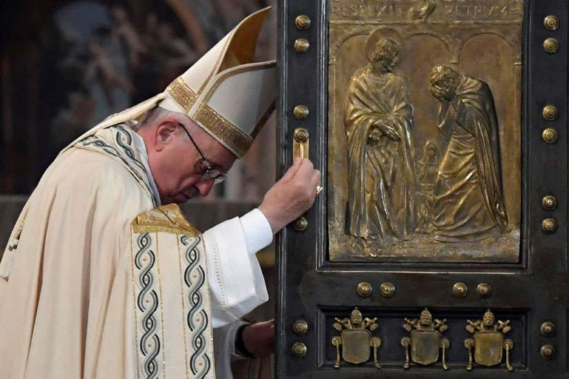 Pope Francis closes the Holy Door of St. Peter's Basilica to mark the closing of the jubilee Year of Mercy at the Vatican Nov. 20.