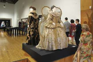 Visitors look at historic costumes worn by actors of several theater companies to represent some of the plays by British playwright William Shakespeare during July's Almagro's Classical Theatre Festival in Almagro, Spain. New historical research suggests that Shakespeare was a secret Catholic at a time when the faith faced persecution in England.
