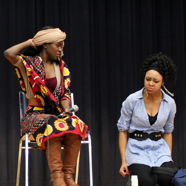 Jullian Namakula, left, and Renita Comrie take to the stage at a past Elevated Grounds performance to educate and fight the stigma surrounding mental health.