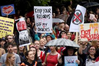 Demonstrators take part in a protest on Sept. 24, 2016, in Dublin to urge the Irish government to repeal the eighth amendment to the constitution, which enforces strict limitations to a woman's right to an abortion.
