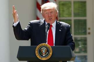 U.S. President Donald Trump announces his decision that the United States will withdraw from the landmark Paris climate agreement June 1 in the Rose Garden of the White House in Washington.