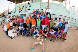 Participants and volunteers pose for a photo at the Holy Childhood Association baseball encounter in Cuba in late May. The camp was hosted by a team of professional baseball coaches and Catholic leaders from the Pontifical Mission Societies in the United States, which oversees the association.