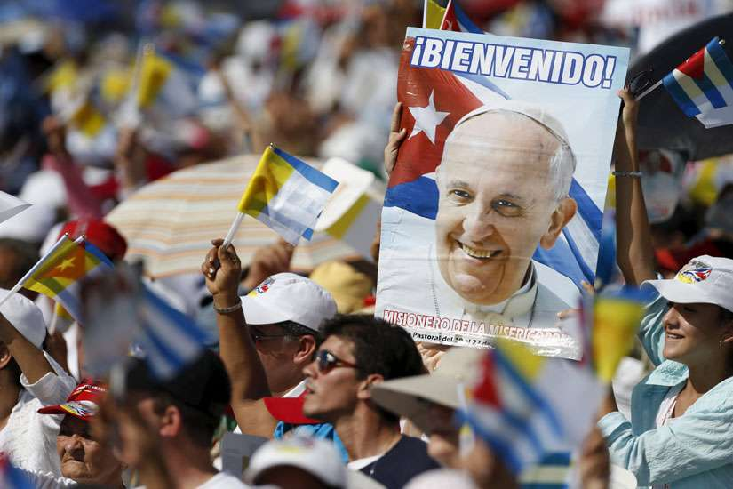 People cheer as Pope Francis arrives for Mass in Revolution Square in Holguin, Cuba, Sept. 21.