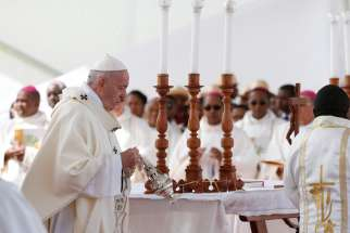 Pope Francis burns incense as he celebrates Mass at the Soamandrakizay diocesan field in Antananarivo, Madagascar, Sept. 8, 2019.