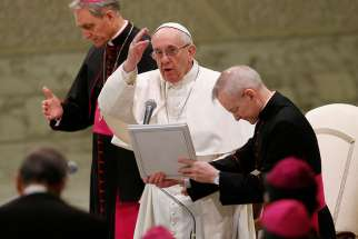 Pope Francis delivers his blessing during his general audience in Paul VI hall at the Vatican Jan. 25.