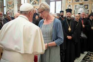 Pope Francis greets Astrid Kaptijn, a professor of canon law and president of the Society for the Law of the Eastern Churches, Sept. 19, 2019, during an audience in the Clementine Hall of the Apostolic Palace at the Vatican.