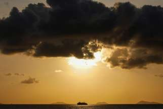 "A ship sails on the Gulf of Thailand during sunset at Ko Samui March 3, 2020. Saying he wanted to renew his ""urgent call to respond to the ecological crisis,"" Pope Francis asked Catholics around the globe to participate in the international observance of ""Laudato Si' Week"" May 16-24."