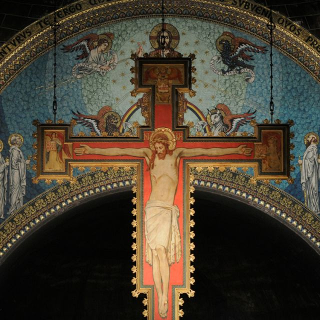 A main focal point of Westminster Cathedral in London is the crucifix that hangs above the sanctuary. The 30-foot-tall wooden icon was constructed in Belgium from designs by John Francis Bentley, the cathedral architect.