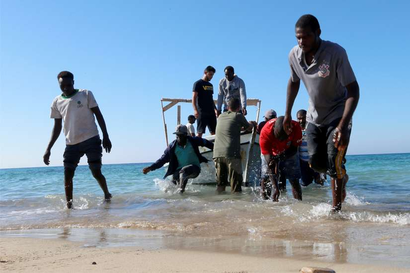 "Migrants are seen after being rescued by the Libyan coast guard, in Tripoli, Libya, July 26, 2019. At least 115 migrants were believed dead after their wooden boat headed for Europe capsized near the north African coast of Libya July 25. Pope Francis in his Angelus message July 28 appealed for the international community to ""act quickly"" to prevent future tragedies."