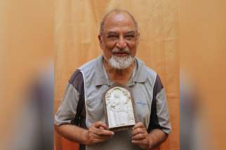 Father Cosme Jose Costa displays an icon of Blessed Joseph Vaz in late October at the Society of Pilar headquarters in Pilar, India. Father Costa's 1938 birth was accepted by the Vatican as the miracle needed to beatify Blessed Vaz in 1995. Blessed Vaz w ill be canonized by Pope Francis Jan. 14 at the Vatican in Sri Lanka.