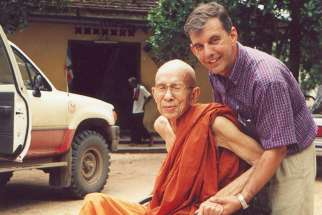 Monsignor Figaredo and a Buddhist monk in a wheelchair in an undated photo in Phnom Penh, Cambodia.