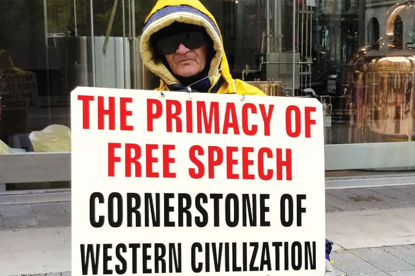 Fr Tony Van Hee SJ, 83, was arrested Oct. 24 for wearing signs in favor of free speech inside the abortion bubble zone.