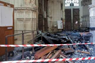 "Debris caused by a fire inside the Cathedral of Sts. Peter and Paul in Nantes, France, is seen July 19, 2020. French police have charged a cathedral volunteer with ""destruction and damage by fire"" in connection to the blaze."