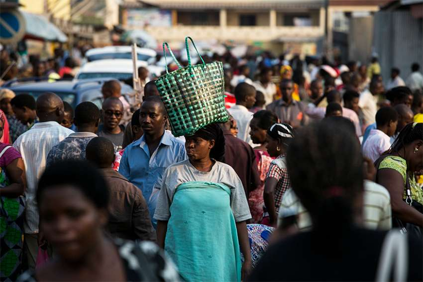 People walk through a market in Bujumbura, Burundi, in this 2015 file photo. Catholic bishops there have criticized an upcoming referendum on constitutional reform that would allow President Pierre Nkurunziza to remain in office till 2034.