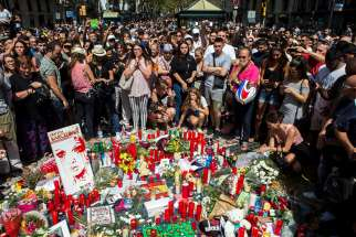 People pay tribute in Barcelona, Spain, Aug. 18, to victims on the site of a deadly van attack the previous day.