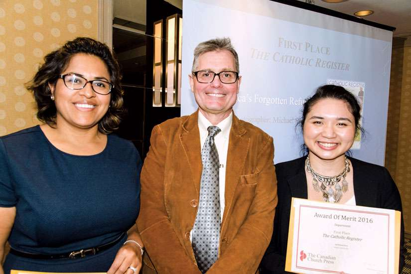 Lucy Barco, Michael Swan and Jean Ko Din are all smiles as they bask in the glory of winning multiple awards at the Canadian Church Press awards ceremony in Toronto April 29. The Catholic Register staffers led the way as The Register took home 14 honours, including eight first-place awards.