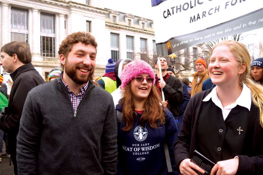 Logan Weir, left, an alumnus of Our Lady Seat of Wisdom College, joins Katherine Duteau and Sr. Courtney Cullen, another alumnus of the Ontario college, at the American National March for Life in Washington, D.C., Jan. 24.