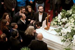 Friends and relatives of Elias Wardini, a Lebanese man killed in a gun attack on the Reina nightclub in Istanbul, mourn during his Jan. 3 funeral Mass at the Church of Our Lady in Beirut. At least 39 people were killed and dozens wounded in the New Year's Eve attack on the nightclub.
