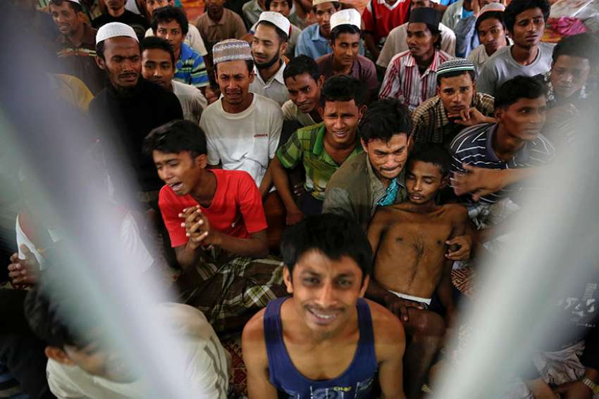 Human trafficking victims from Myanmar are held in a detention cell near the Thailand-Malaysian border, Feb. 13, 2014.