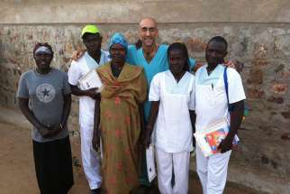 Dr. Tom Catena is pictured with his medical team in outside Mother of Mercy Hospital in Gidel, Sudan, in 2013. Catena, a U.S. Catholic physician and missionary who serves in Sudan, has received the Aurora Prize for Awakening Humanity.
