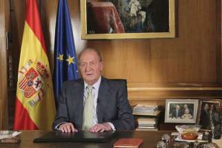 A pool picture released by the Spanish Royal Household June 2 shows Spain's King Juan Carlos delivering a speech to explain the reasons for his abdication on a TV broadcast after the abdication was announced by Spanish Prime Minister Mariano Rajoy.