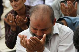 Pakistani Muslims pray during Ramadan in Karachi. Pakistan has seen more than 62 people killed since 1990 by mob violence.