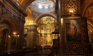The Pope requested private prayer time before the image of Our Lady of Sorrows, which hangs over the altar in Iglesia de la Compania, in Quito's colonial-era Jesuit church.