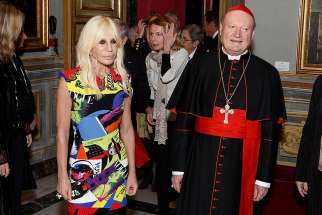 "Italian fashioner designer Donatella Versace and Cardinal Gianfranco Ravasi, president of the Pontifical Council for Culture, arrive for a press presentation for the exhibit, ""Heavenly Bodies: Fashion and the Catholic Imagination,"" at Galleria Colonna in Rome Feb. 26."