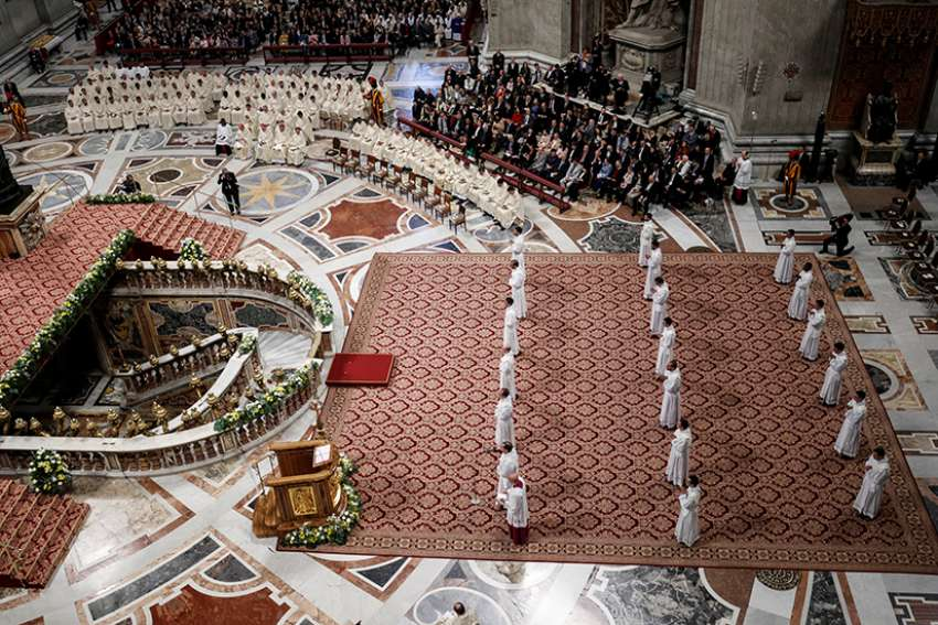 Newly ordained priests stand as Pope Francis celebrates an ordination Mass in St. Peter's Basilica at the Vatican May 12, 2019. The pope ordained 19 new priests.