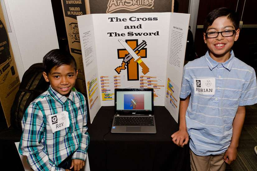 Grade five students from St. Justin Martyr Catholic School in Markham, Roy Halog and Adrian di Paolas (left to right), showcase their game The Cross and the Sword.