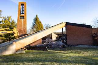 The bell tower of Most Blessed Sacrament Church in Franklin Lakes, N.J., is seen standing Dec. 12, 2019, after a fire destroyed the rest of the church the previous morning. One person suspected of arson is in custody, officials said. The structure was gutted by the flames, and as the news spread through the small town, neighbors, some of whom have been a part of the congregation for decades, flocked to the scene.